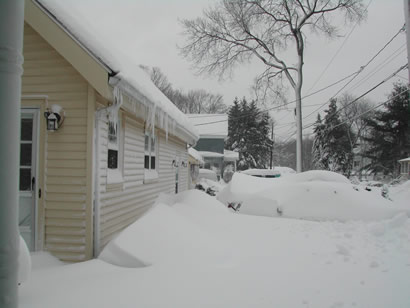 Picture of the front of our new place after the big storm in December